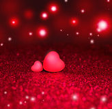 Two Hearts On Red Sparkle Glitter Background Royalty Free Stock Photo