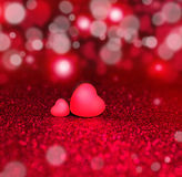 Two Hearts On Red Sparkle Glitter Background Stock Photography