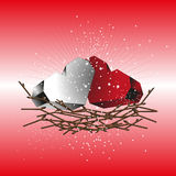 Two hearts red and white in a nest of twigs Stock Image