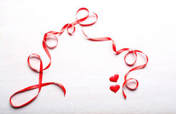 Two hearts and ribbon Stock Image