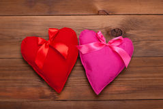 Two hearts with ribbon Stock Images