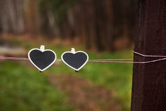 Two hearts on a rope in a forest stock image