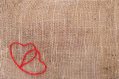 Two hearts on sackcloth Stock Photography