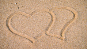 Two Hearts in the Sand on the Beach Stock Photography
