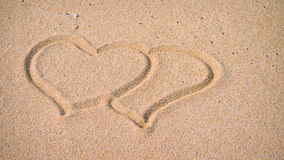 Two Hearts in the Sand on the Beach Royalty Free Stock Image