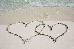 Two hearts in the sand beach Royalty Free Stock Photo