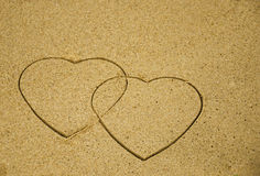 Two hearts on sand Stock Photography