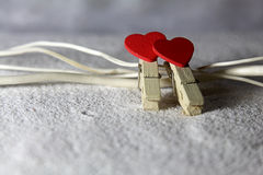 Two hearts on the sand Stock Images