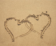 Two hearts on sandy beach Royalty Free Stock Photo