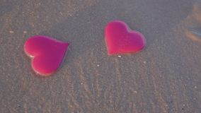 Two hearts on the sea beach. vacation, love concept. Heart on the sea beach, slow motion stock video footage