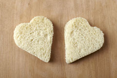 Two hearts shape of bread Stock Photos