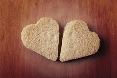 Two hearts shape of bread royalty free stock photo