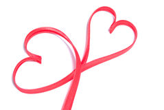 Two hearts shapes made of red ribbon Royalty Free Stock Photography