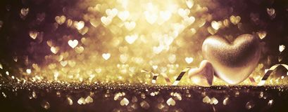 Hearts On Shiny Gold Background Royalty Free Stock Photography