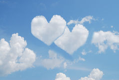 Two hearts in sky. Two hearts from white clouds in blue sky Royalty Free Stock Photography