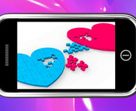 Two Hearts On Smartphone Showing Commitment Royalty Free Stock Images