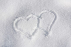 Two hearts in the snow Stock Image