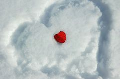 Two hearts and snow Stock Photo