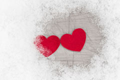 Two hearts among snow Royalty Free Stock Photo