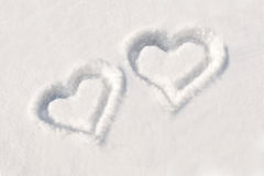 Two hearts in snow Royalty Free Stock Images