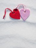 Two hearts on snow Royalty Free Stock Photo