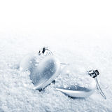 Two hearts on snow Royalty Free Stock Image