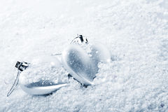 Two hearts on snow Stock Images