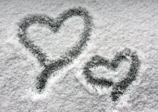Two hearts on snowy window Royalty Free Stock Photos