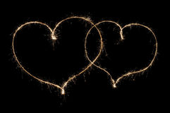 Two hearts from sparkler Stock Photography