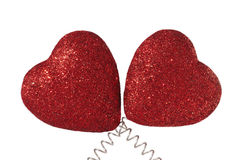 Two Hearts On Spring Wire Isolated on White. Two Red Glittery Hearts Isolated on White Background Royalty Free Stock Photo