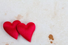 Two hearts on stained paper Royalty Free Stock Photo