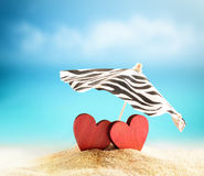 Two hearts on the summer beach Stock Photos