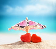 Two hearts on the summer beach Stock Images