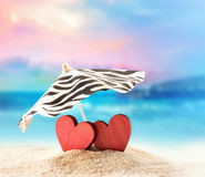 Two hearts on the summer beach Stock Image
