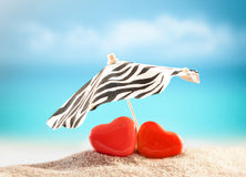 Two hearts on the summer beach Stock Photography