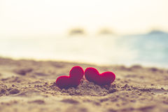 Two hearts on the summer beach Royalty Free Stock Images