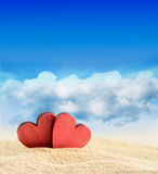 Two hearts on the summer beach Royalty Free Stock Image