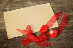 Two hearts tied with red ribbon Royalty Free Stock Photography
