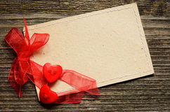Two hearts tied with red ribbon Stock Photos