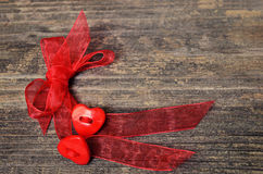 Two hearts tied red ribbon Stock Photography