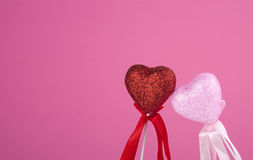 Two hearts together on pink background. Two loving hearts together on pink background Royalty Free Stock Photo