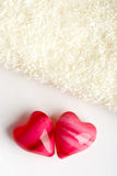 Two hearts with towel Stock Images