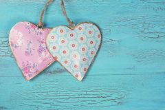 Two hearts. On a blue wooden background royalty free stock images