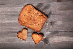 Two hearts which are cut out in a piece of rye bread and two mor Royalty Free Stock Photography