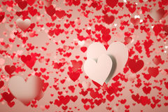 Two hearts. Two white hearts on a background full of red hearts with shallow depth of field Stock Photos