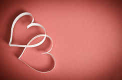 Two hearts of white paper on a red background Royalty Free Stock Photo