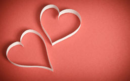 Two hearts of white paper on a red background Royalty Free Stock Images