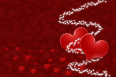 Two hearts with a white stars on a red background. Stock Photos