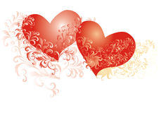 Two hearts whith flower ornaments stock images