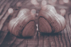 Two hearts of wood in sepia Royalty Free Stock Photography